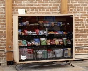 Bodega cabinet stocked with snacks